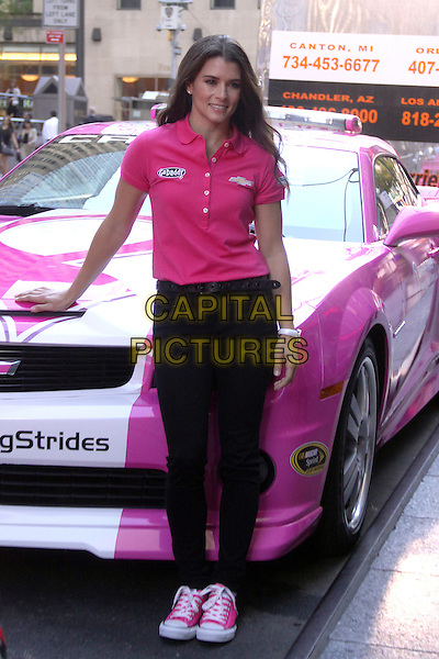 Danica Patrick <br /> seen outside of Fox and Friends TV Studio in New York City, NY., USA.<br /> October 1st, 2013<br /> full length pink top polo shirt black jeans denim car<br /> CAP/MPI/RW<br /> &copy;RW/ MediaPunch/Capital Pictures