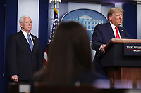 United States President Donald J. Trump speaks as US Vice President Mike Pence listens during a press conference with members of the coronavirus task force in the Brady Press Briefing Room of the White House on March 24, 2020 in Washington, DC.<br /> Credit: Oliver Contreras / Pool via CNP/AdMedia