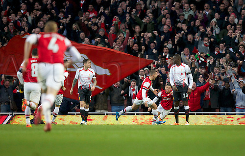 16.02.2014 London, England.  Lukas Podolski of Arsenal celebrates his goal during the FA Cup 5th Round game between Arsenal and Liverpool from the Emirates Stadium.