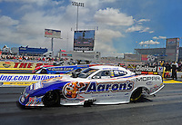 Apr. 1, 2012; Las Vegas, NV, USA: NHRA funny car driver Matt Hagan (near lane) races alongside Bob Tasca III during the Summitracing.com Nationals at The Strip in Las Vegas. Mandatory Credit: Mark J. Rebilas-