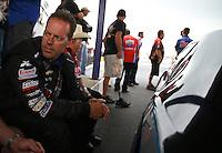 Apr. 27, 2013; Baytown, TX, USA: NHRA pro stock driver Jason Line during a rain delay to qualifying for the Spring Nationals at Royal Purple Raceway. Mandatory Credit: Mark J. Rebilas-
