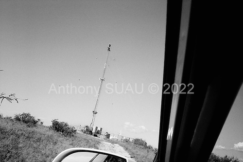 Sasabe, Arizona<br /> USA<br /> August 25, 2007<br /> <br /> One of Boeing's nine high-tech camera-towers costing $67 million to install along the Mexican border. It is to monitor the flow of illegal immigration and drug traffic. The Border Patrol officers claim that it has proved particularly troublesome.<br /> <br /> The plan is to secure the area around Sasabe with a network of nine pole-mounted cameras, radar and ground sensors. <br /> <br /> The technology is a cornerstone of the government's border strategy for life after the National Guard. Ultimately, there may be as many as 1,800 towers strung along the border.<br /> <br /> The devices are supposed to focus cameras on targets moving across the border and relay, via satellite uplink, the information to a command center instantaneously. Then an image of the crossers is supposed to go straight to a patrol truck. <br /> <br /> But the cameras track targets 30 seconds late, and rain can disrupt the ultra-sensitive radars, say federal and congressional sources with intimate knowledge of the project. Those sources say contractors underestimated the challenge of integrating off-the-shelf technology on the border. Congressional auditors are in Arizona to investigate.