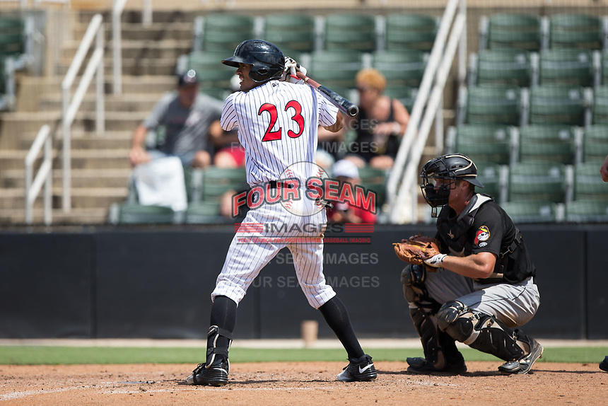 Joel Booker (23) of the Kannapolis Intimidators at bat against the West Virginia Power at Kannapolis Intimidators Stadium on June 18, 2017 in Kannapolis, North Carolina.  The Intimidators defeated the Power 5-3 to win the South Atlantic League Northern Division first half title.  It is the first trip to the playoffs for the Intimidators since 2009.  (Brian Westerholt/Four Seam Images)