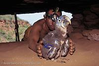 Former Macaw Trapper Raimondo Conçalves checking 30-days-old nestling in a nesting cave high in a cliff, Chapada das Mangabeiras, southern Piauí State, NE Brazil.