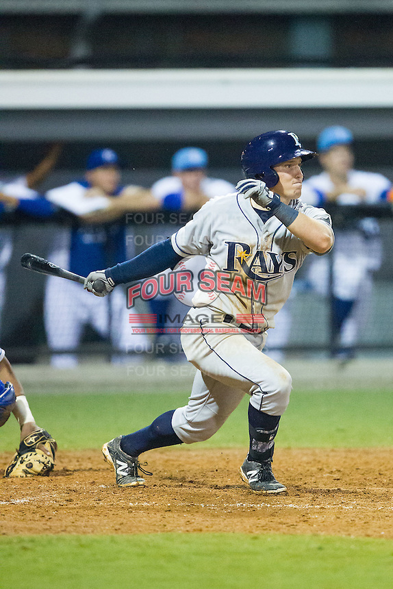 Riley Unroe (1) of the Princeton Rays follows through on his swing against the Burlington Royals at Burlington Athletic Park on July 9, 2014 in Burlington, North Carolina.  The Rays defeated the Royals 3-0.  (Brian Westerholt/Four Seam Images)