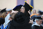 Instructor Rebecca Bevans hugs graduate Stephanie Cisneros during the 45th annual Western Nevada College Commencement ceremony in Carson City, Nev., on Monday, May 23, 2016. A record 556 graduates received 598 degrees.<br />