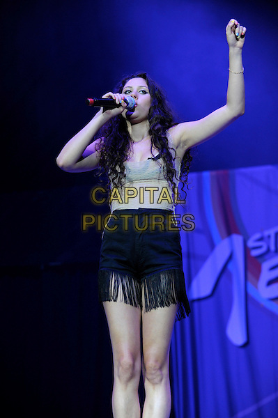 ELIZA DOOLITTLE .Performs at the 1st Birthday Party of The Transformation Trust at the O2 Arena, London, England..July 13th, 2010.length stage concert live gig performance music half grey gray top black shorts singing tassels fringed 3/4 full hand arm .CAP/IA.©Ian Allis/Capital Pictures.