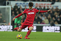 Ki Sung-Yueng of Swansea City takes a cross during the Premier League match between Newcastle United and Swansea City at St James' Park, Newcastle, England, UK. Saturday 13 January 2018