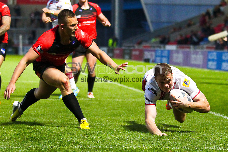 Picture by Alex Whitehead/SWpix.com - 22/05/2014 - Rugby League - First Utility Super League - Salford Red Devils v Wigan Warriors - AJ Bell Stadium, Salford, England - Wigan's Joe Burgess scores a try.