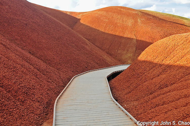 Boardwalk trail winds through the red hills of Painted Cove at Painted Hills National Monument, Oregon