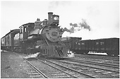 Passenger train with ten-wheeler ready to depart.  Three-rail track.<br /> D&amp;RG  probably Grand Junction, CO  Taken by Mollette, Erskine (Rex)