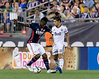 Foxborough, Massachusetts - August 12, 2017: First half action. In a Major League Soccer (MLS) match, New England Revolution (blue/white) vs Vancouver Whitecaps (white), at Gillette Stadium.