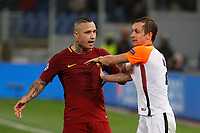 Roma s Radja Nainggolan, left, argues with Shakhtar Donetsk Bohdan Butko during the Uefa Champions League round of 16 second leg soccer match between Roma and Shakhtar Donetsk at Rome's Olympic stadium, March 13, 2018. Roma won. 1-0 to join the quarter finals.<br /> UPDATE IMAGES PRESS/Riccardo De Luca