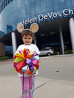 "Pictured: Mia Chambers at the hospital where she received treatment in the USA<br /> Re: A caring schoolgirl who beat cancer has helped save another child with the disease who was let down by the NHS.<br /> Libby Jones, 13, stepped in when funding wasn't available to send five-year-old Mia Chambers for pioneering treatment in America.<br /> Caring Libby asked her classmates to wear all the colours of the rainbow and donate £1.<br /> She came up with ""Rainbow Day for Mia"" which spread to shops, pubs, clubs, and businesses for miles around.<br /> An incredible £280,000 was raised and Mia was yesterday in Michegan getting the treatment which could save her life.<br /> Libby, who had eye cancer, said: ""I was lucky - the NHS paid for me to go to America.<br /> ""But it was different for Mia and her parents couldn't afford to take her there.<br /> ""So I had a brainwave to ask children in my school to wear all the colours of the Rainbow.""<br /> With help from mum Lindsey the idea was taken up by 27 schools in Merthyr Tydfil, South Wales, where Libby and Mia live."