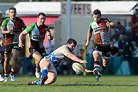 Danny Care of Harlequins chips upfield during the Aviva Premiership match between Harlequins and Bath Rugby at The Twickenham Stoop on Saturday 24th March 2012 (Photo by Rob Munro)