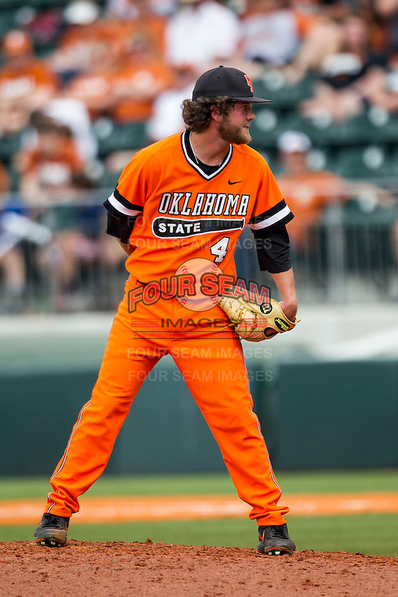 Oklahoma State Cowboys pitcher Brendan McCurry #4 looks to his catcher for the sign during the NCAA baseball game against the Texas Longhorns on April 26, 2014 at UFCU Disch–Falk Field in Austin, Texas. The Cowboys defeated the Longhorns 2-1. (Andrew Woolley/Four Seam Images)