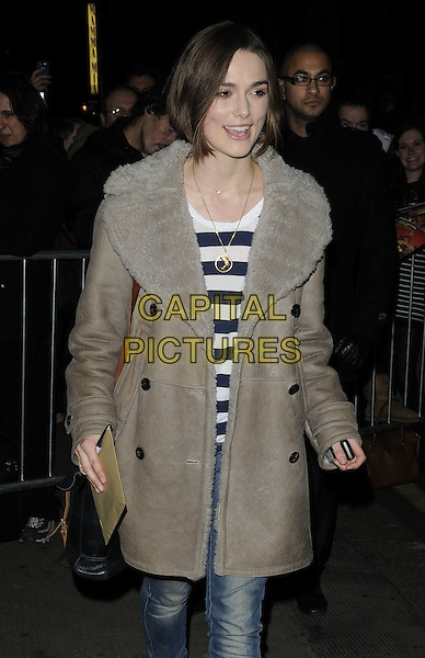 """KEIRA KNIGHTLEY .Leaving after the evening performance of """"The Children's Hour"""", The Comedy Theatre, London, England, UK, February 4th 2011..half length brown grey gray sheepskin fur collar coat jeans striped top black bag shoulder strap gold necklace .CAP/CAN.©Can Nguyen/Capital Pictures."""