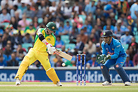 David Warner (Australia) chops the ball down and over his stumps during India vs Australia, ICC World Cup Cricket at The Oval on 9th June 2019