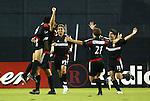 18 September 2004: After scoring his first MLS goal, Christian Gomez (left) is lifted by Mike Petke as Jaime Moreno (99), Dema Kovalenko (21), and Alecko Eskandarian (11) rush to join the celebration. The eighth minute strike gave United a 1-0 lead. DC United defeated the Chicago Fire 3-1 at RFK Stadium in Washington, DC in a regular season Major League Soccer game..