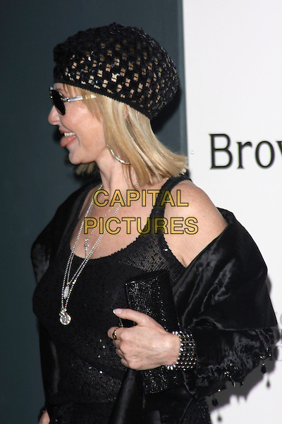 LULU KENNEDY-CAIRNS.Attends the 40th anniversary celebrations of Browns fashion boutique, Marshall Street, London, England, UK, May 12th, 2010..arrivals half length black beanie hat jacket sunglasses beret vest sparkly side profile tongue sticking out funny  clutch bag silver necklaces necklace .CAP/AH.©Adam Houghton/Capital Pictures.