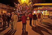 Members from the Occidental Choir sings Christmas carols at night at the annual tree lighting ceremony in Occidental California