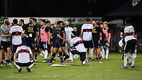 LAKE BUENA VISTA, FL - JULY 26: Graham Zusi of Sporting KC tries to console Derek Cornelius of Vancouver Whitecaps FC during a game between Vancouver Whitecaps and Sporting Kansas City at ESPN Wide World of Sports on July 26, 2020 in Lake Buena Vista, Florida.