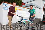 Sean Scally from Enable Ireland Kerry Services accepting a cheque from Tommy Sheehy who raised €12,186 after an eight hour spinning session.