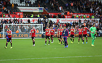 Pictured: Disappointed Manchester United players walk off the pitch after the end of the game Sunday 30 August 2015<br /> Re: Premier League, Swansea v Manchester United at the Liberty Stadium, Swansea, UK