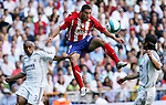 Atletico de madrid's Maxi Rodriguez heads past  Real Madrid's Roberto Carlos and Sergio Ramos during Spanish La Liga match between Real Madrid and Atletico de Madrid at Santiago Bernabeu stadium in Madrid, Sunday 01 October, 2006. (ALTERPHOTOS/Alvaro Hernandez).