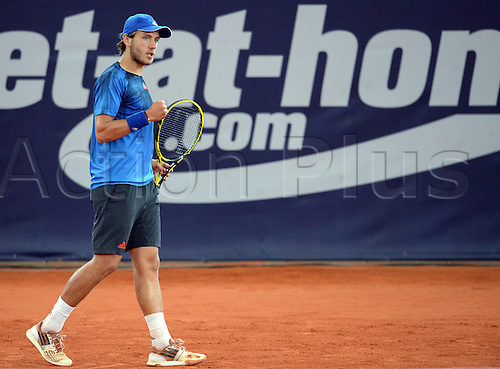 29.07.2015. Hamburg, Germany.  Lucas Pouille of France reacts during the round of 16 match against Monaco of Argentina at the ATP tennis tournament in Hamburg, Germany, 29 July 2015.