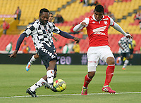 BOGOTA - COLOMBIA -22 -03-2014: Enrique Perez (Der.) jugador de Independiente Santa Fe disputa el balón con Jairo Castillo (Izq.) jugador de Boyaca Chico FC, durante partido por la fecha 12 de la Liga Postobon I-2014, jugado en el estadio Nemesio Camacho El Campin de la ciudad de Bogota. /  Enrique Perez  (L) jugador of Independiente Santa Fe vies for the ball with Jairo Castillo (L) player of Boyaca Chico FC during a match for the 12th date of the Liga Postobon I-2014 at the Nemesio Camacho El Campin Stadium in Bogota city, Photo: VizzorImage  / Felipe Caicedo / Staff.