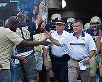 Pitt head coach Todd Graham leading the team onto the field for the first time.. The Pittsburgh Panthers beat the Buffalo Bulls 35-16 at Heinz field in Pittsburgh, Pennsylvania on September 3, 2011
