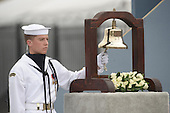 Arlington, VA - September 11, 2008 -- A United States Navy Sailor rings a bell as the name of each person lost at the Pentagon is read during the Pentagon Memorial dedication ceremony Sept. 11, 2008. The national memorial consists of 184 inscribed memorial units honoring the 59 people aboard American Airlines Flight 77 and the 125 in the building who lost their lives Sept. 11, 2001. .Credit: Chad McNeeley - DoD via CNP