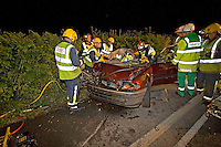 Firefighters and Paramedic crews work together to release the trapped driver of a two car accident Oxfordshire UK. This image may only be used to portray the subject in a positive manner..©shoutpictures.com..john@shoutpictures.com
