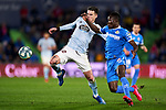 Dakonam Djene of Getafe FC and Rafinha Alcantara of RC Celta de Vigo during La Liga match between Getafe CF and RC Celta de Vigo at Coliseum Alfonso Perez in Getafe, Spain. March 07, 2020. (ALTERPHOTOS/A. Perez Meca)