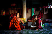 Monks from the Myazeda Man Oo Monastery, where they produce promotional material and literature for the Buddhist nationalist 969 movement, read in in their quarters in Mawlamyine, Mon State. /Felix Features