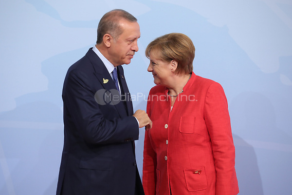 German chancellor Angela Merkel greets the Turkish president Recep Tayyip Erdogan at the G20 summit in Hamburg, Germany, 7 July 2017. The heads of the governments of the G20 group of countries are meeting in Hamburg on the 7-8 July 2017. Photo: Michael Kappeler/dpa /MediaPunch ***FOR USA ONLY***