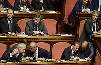 Roma, 2 Ottobre 2013<br /> Senato <br /> Silvio Berlusconi parla con Domenico Scilipoti sugli scranni del PDL durante l'intervento del Primo  Ministro Enrico Letta