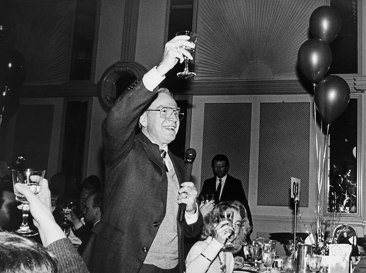 Rep. Jim Wright, D-Texas, toasting at a party. 1988 (Photo by CQ Roll Call)