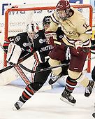 Dax Lauwers (NU - 44), Kevin Hayes (BC - 12) - The Boston College Eagles defeated the visiting Northeastern University Huskies 3-0 after a banner-raising ceremony for BC's 2012 national championship on Saturday, October 20, 2012, at Kelley Rink in Conte Forum in Chestnut Hill, Massachusetts.