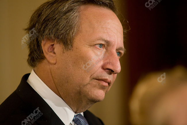 Lawrence Summers, economic adviser to President Barack Obama, looks on as Obama signs executive orders. The White House, Washington D.C., USA, January 30, 2009