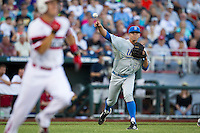 UCLA pitcher Nick Vander Tuig (21) makes a throw to first base after a bunt against the North Carolina State Wolfpack during Game 8 of the 2013 Men's College World Series on June 18, 2013 at TD Ameritrade Park in Omaha, Nebraska. The Bruins defeated the Wolfpack 2-1, eliminating North Carolina State from the tournament. (Andrew Woolley/Four Seam Images)