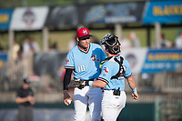 Hickory Crawdads starting pitcher Hans Crouse (10) talks things over with catcher Matt Whatley (19) during a game with the Asheville Tourists at L.P. Frans Stadium on May 8, 2019 in Hickory, North Carolina. The Tourists defeated the Crawdads 7-6. (Tracy Proffitt/Four Seam Images)