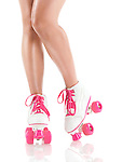 Closeup of sexy young woman legs wearing white with pink classic roller skates isolated on white background