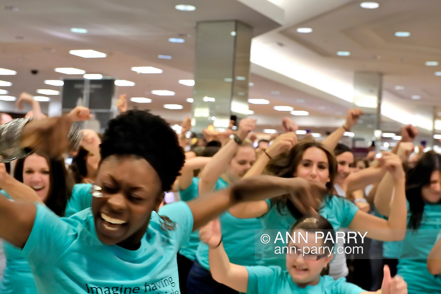 """Flash Mob dance event for Estee Lauder at Macy's in Long Island, New York, USA, on July 23, 2011. Teal shirts dancers wearing have """"Imagine having nothing to hide"""" written on front."""