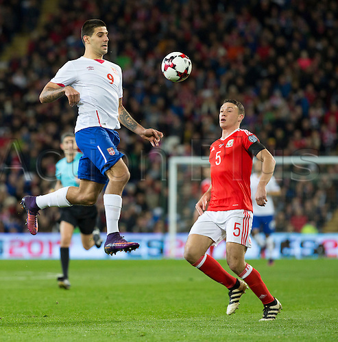 12.11.2016. Cardiff City Stadium, Cardiff, Wales. World Cup Qualifying Football. Wales versus Serbia. Serbia striker Aleksandar Mitrovic chests the ball in the air watched by Wales defender James Chester.