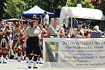 Members of the Amerscots Highland Pipe Band parading in the Saugerties July 4th Parade on Main Street in Saugerties, NY on Monday, July 4, 2011. Photo by Jim Peppler. Copyright © Jim Peppler 2011.