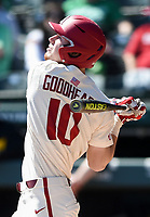 NWA Democrat-Gazette/CHARLIE KAIJO Arkansas Razorbacks Matt Goodheart (10) swings during a baseball game, Sunday, March 17, 2019 at Baum-Walker Stadium in Fayetteville.
