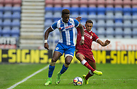 Omar Bogle of Wigan Athletic battles Trent Alexander-Arnold of Liverpool during the pre season friendly match between Wigan Athletic and Liverpool at the DW Stadium, Wigan, England on 14 July 2017. Photo by Andy Rowland.