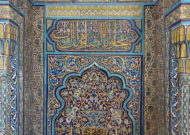 Iznik tile decoration on the mihrab of the Green Tomb or Yesil Turbe, mausoleum of the 5th Ottoman Sultan Mehmed I Celebi, Bursa, Turkey. The tomb was built by Mehmed's son and successor Murad II following Mehmed's death in 1421 and is so named because of the green-blue tiles which cover the exterior. The architect, Haci Ivaz Pasha, designed the tomb and the Yesil Mosque opposite. Picture by Manuel Cohen